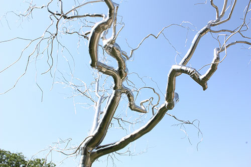 Metal tree sculpture by Roxy Paine