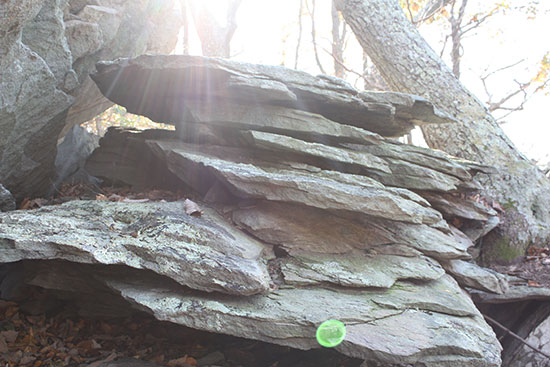 Stack of rocks with sunlight streaming over them