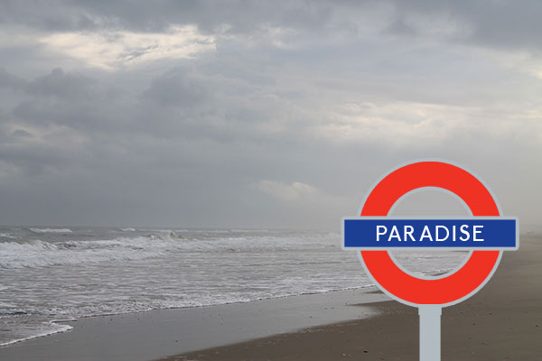 Paradise Tube Sign on Beach