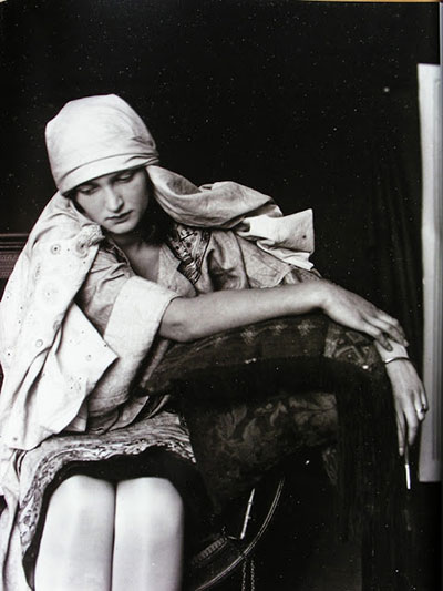 Alphonse Mucha photo of woman looking pensive
