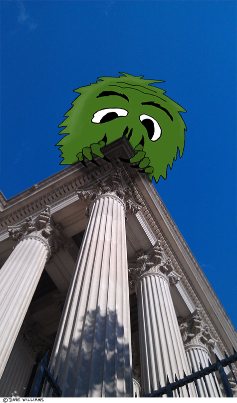 Monster looking over roof of building with columns