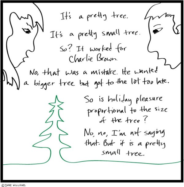 Two people talking about a small Christmas tree