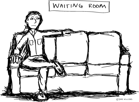 Man sits on a couch in a hospital waiting room